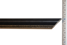 Thin, bevelled wood frame with distressed bronze inner edge. 20mm